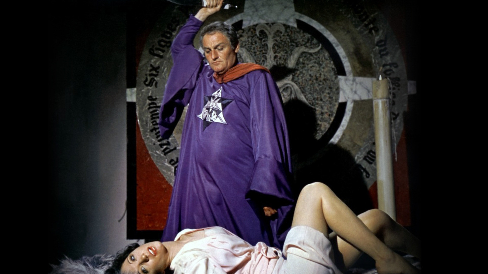 Mocata (Charles Gray) prepares to sacrifice Niké Arrighi in The Devil Rides Out (1968)