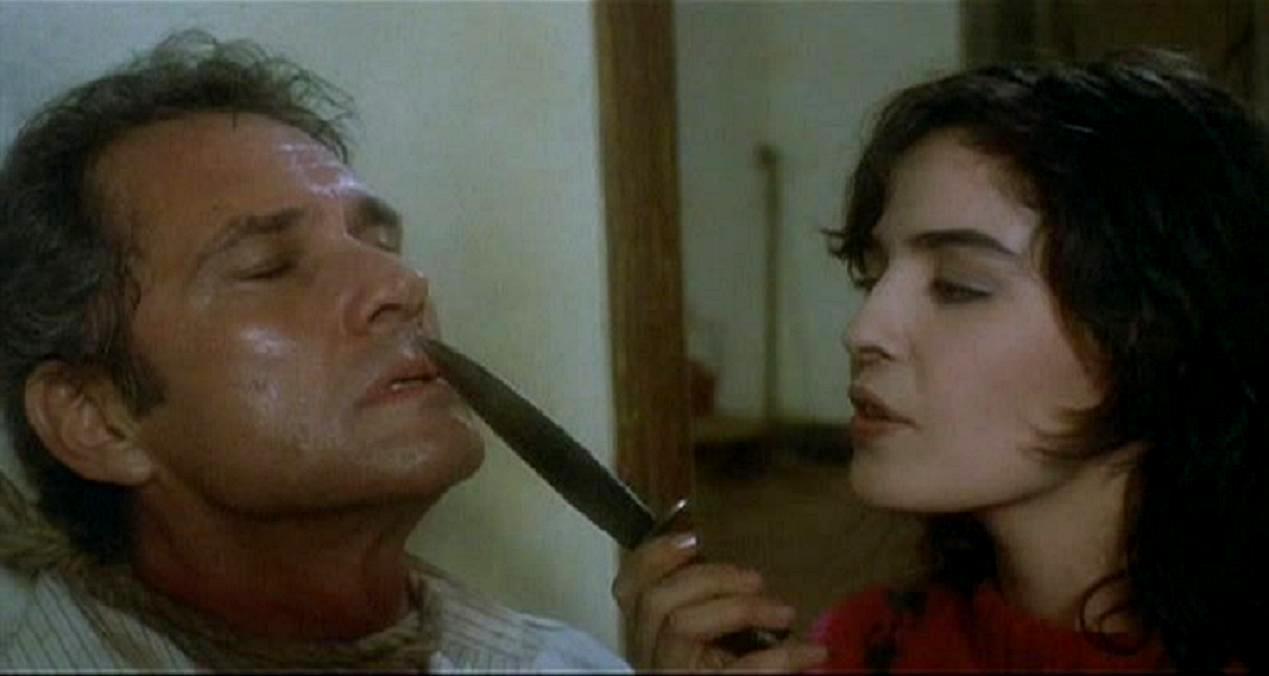 Brett Halsey held as prisoner by Blanca Marsillach in The Devil's Honey (1986)