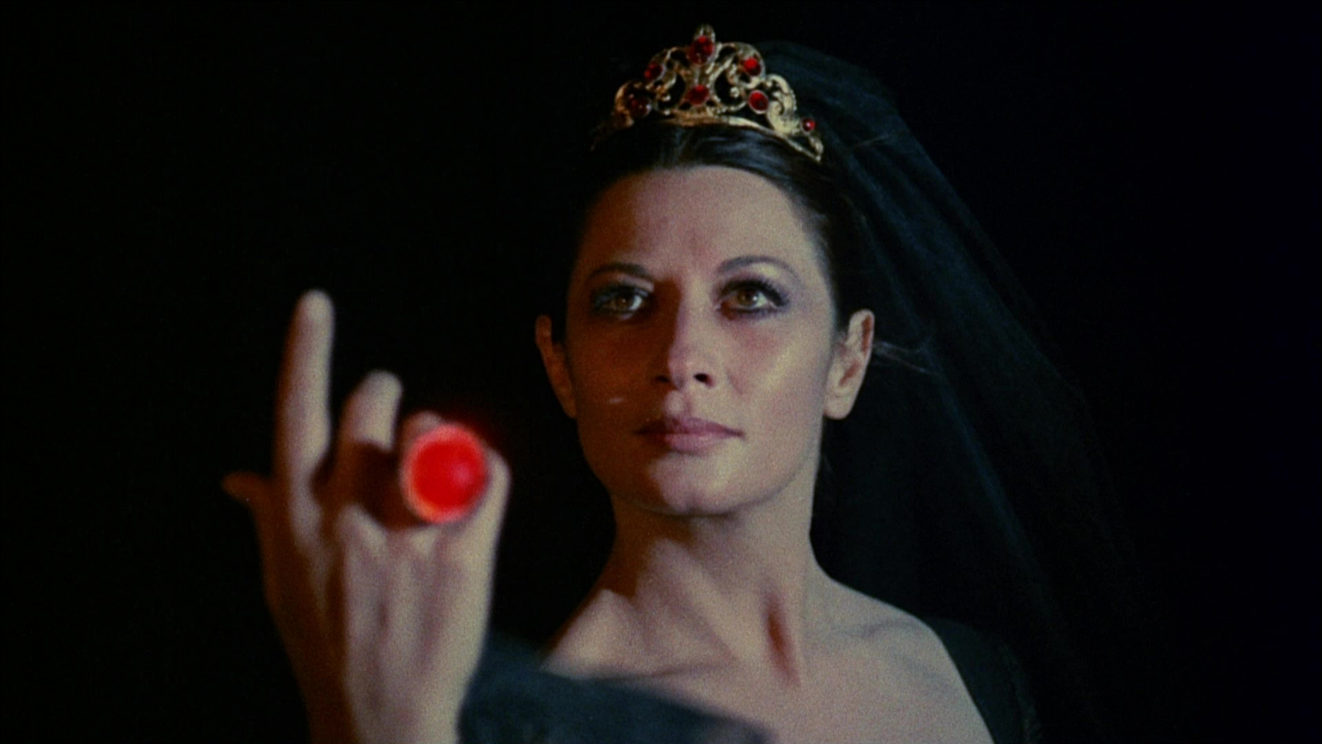 Countess Dolingen de Vries (Sara Bay/Rosalba Neri) wields the Ring of the Niebelungs in The Devil's Wedding Night (1973)