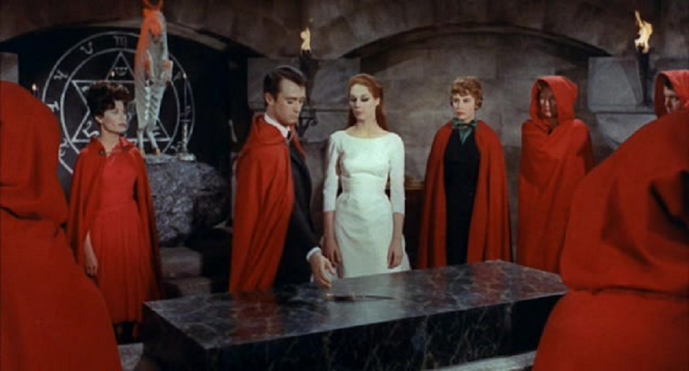 Count Sinistre (Hubert Noel) leads the cult in sacrifice in Devils of Darkness (1965)