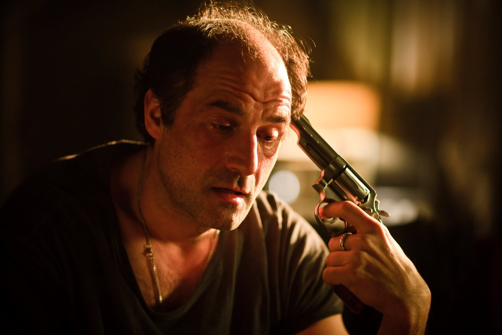Detective Elias Koteas engages in a game of Russian Roulette in Die (2010)
