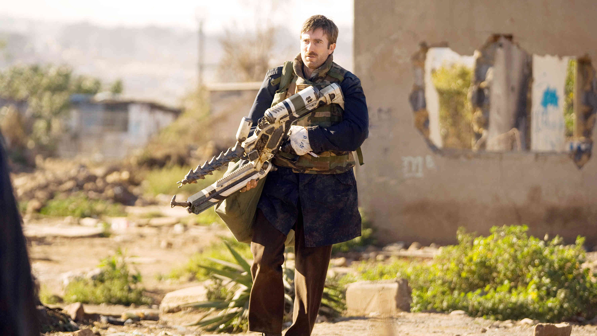Sharlto Copley undergoes transformation into something alien in District 9 (2009)