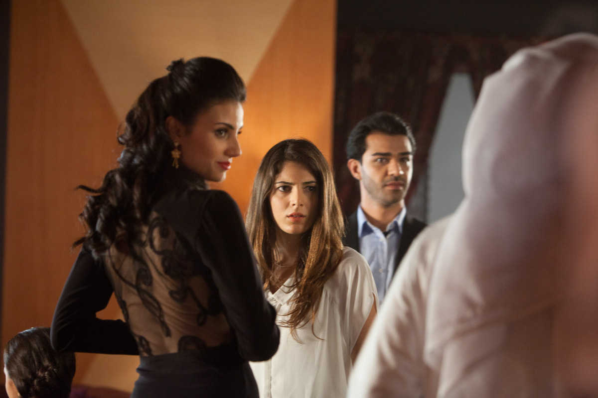 (l to r) Aiysha Hart, wife Razane Jammal and husband Khalid Laith in Djinn (2013)
