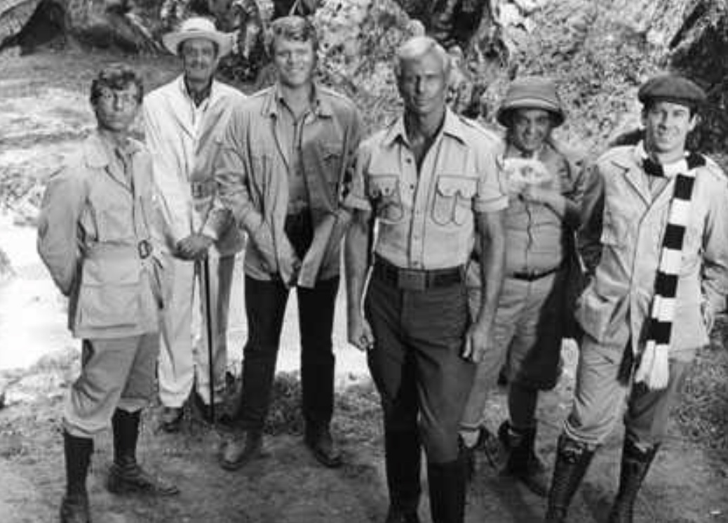 Doc Savage and the Brain Trust - (l to r) Johnny Littlejohn (Eldon quick), Ham Brooks (Darrell Zwerling), Renny Renwick (William Lucking), Doc Savage (Ron Ely), Monk Mayfair (Michael Miller) and Long Tom Roberts (Paul Gleason) in Doc Savage –The Man of Bronze (1975)