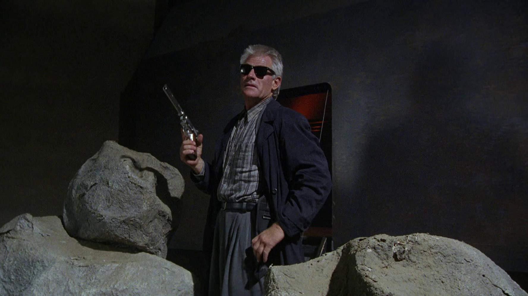 Tim Thomerson as miniature alien cop Brick Bardo in Dollman (1990)
