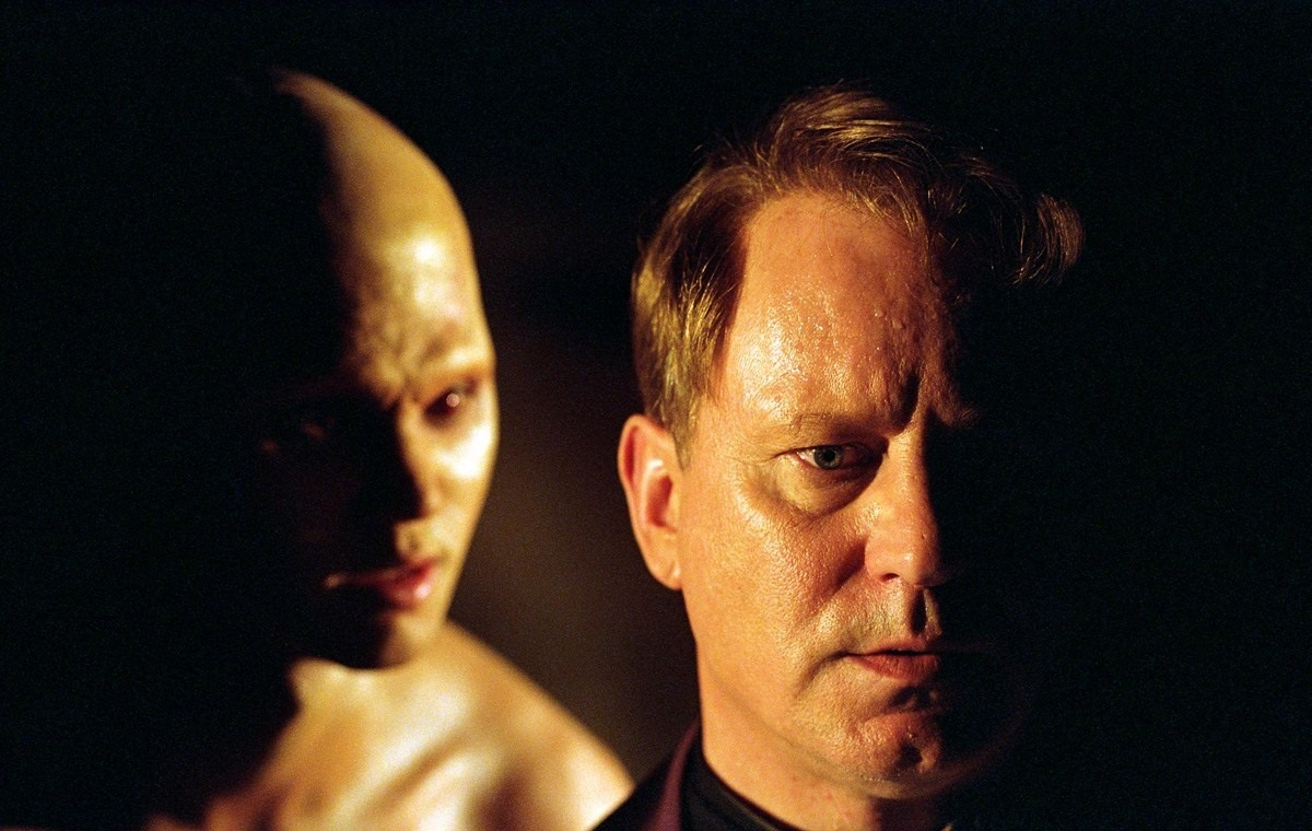 Father Merrin (Stellan Skarsgård) taunted by demonic forces in Dominion: Prequel to The Exorcist (2005)