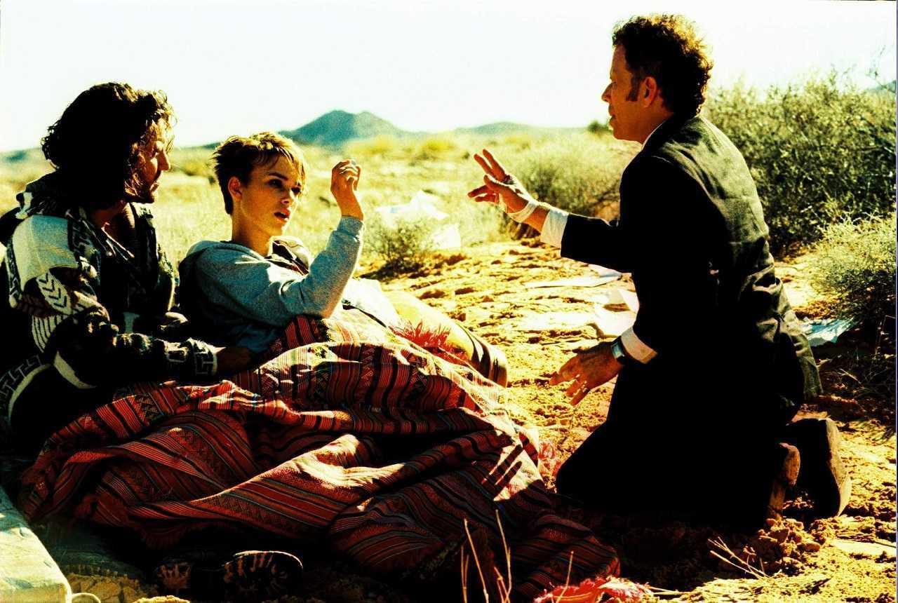 Choco (Edgar Ramirez) and Domino Harvey (Keira Knightley) meet The Wanderer (Tom Waits)