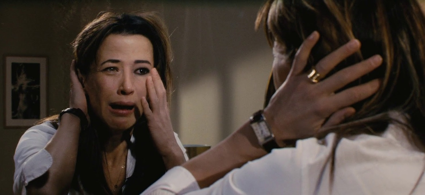 Sophie Marceau sees someone else's reflection in Don't Look Back (2009)