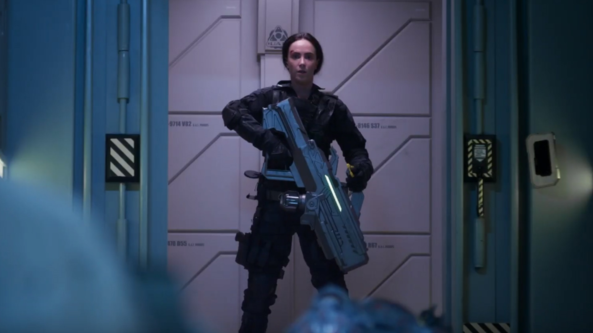 Lieutenant Joan Dark (Amy Manson) goes into action with the BFG in Doom: Annihilation (2019)