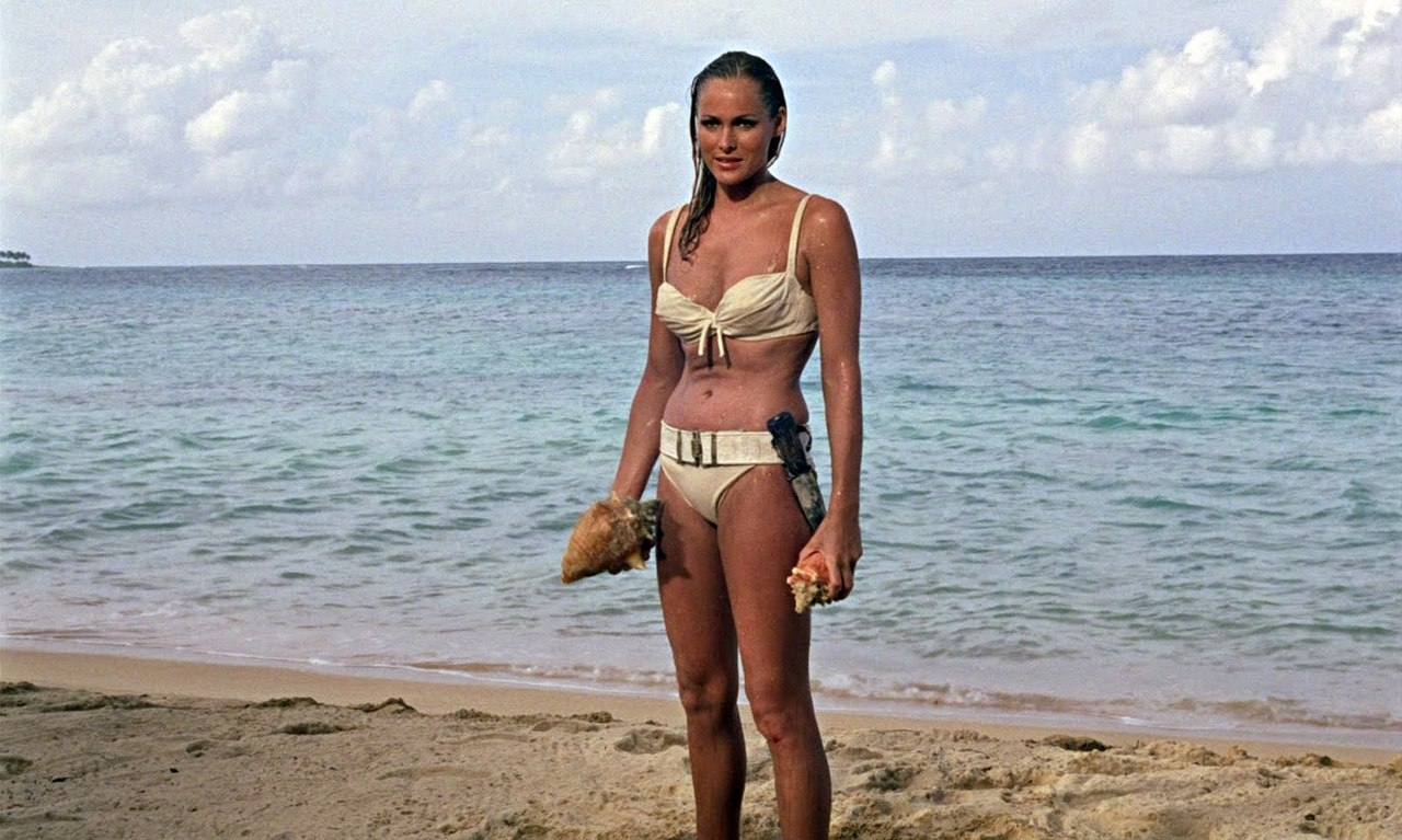 The first of the Bond girls - Ursula Andress as Honeychile Rider in her iconic entrance from out of the sea in a bikini in Dr No (1962)