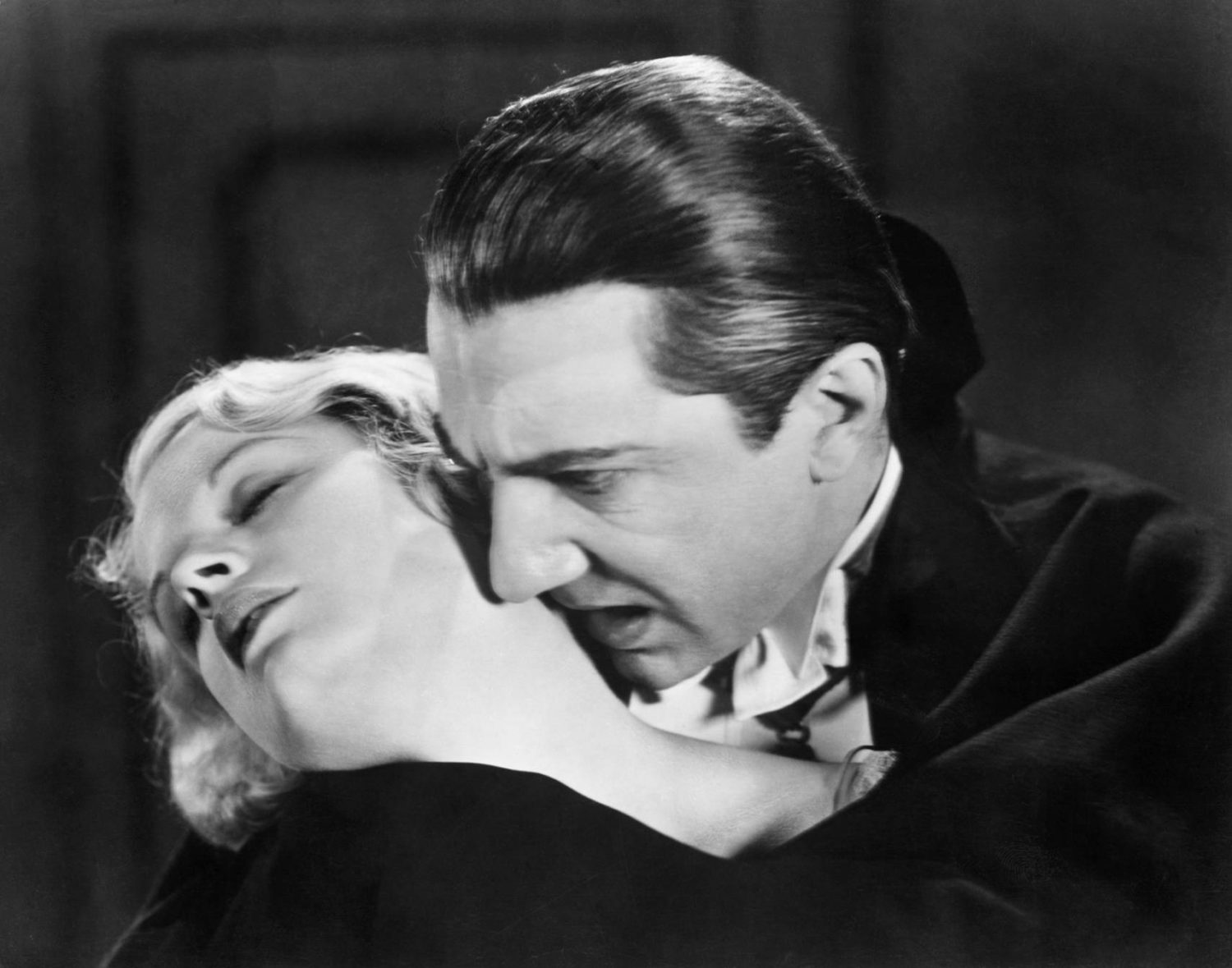 Bela Lugosi sinks his teeth into Helen Chandler's neck in Dracula (1931)