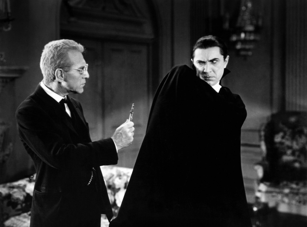Van Sloan) wields crucifix at Dracula (Bela Lugosi)
