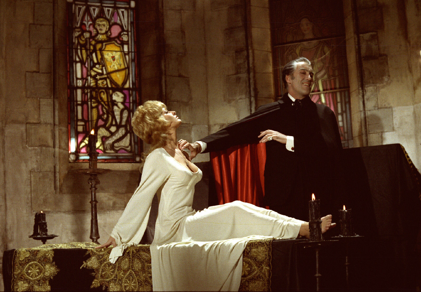 Dracula (Christopher Lee) tries to sneak a grope of Stephanie Beacham's cleavage in Dracula A.D. 1972 (1972)