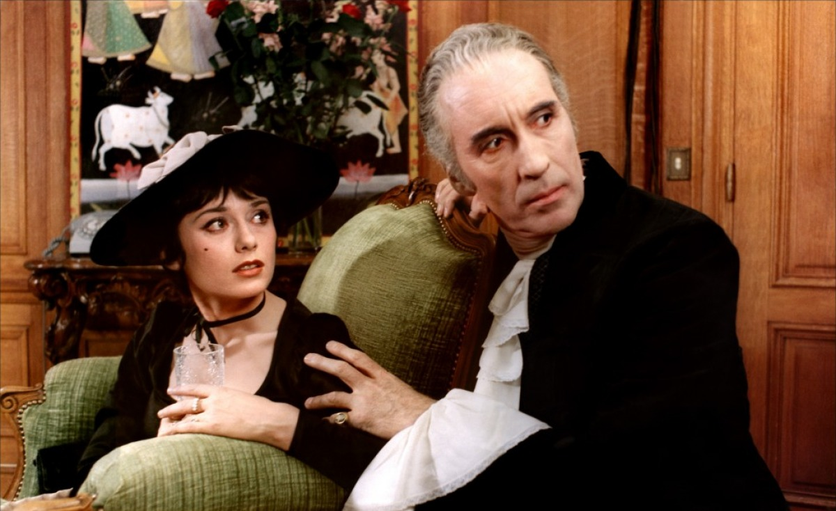 Dracula (Christopher Lee) interrupted in his dealings with Marie-Helene Breillat in Dracula Father and Son (1976)