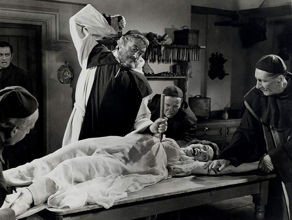 Father Shandor (Andrew Keir) (c) hammers a stake into Barbara Shelley in Dracula - Prince of Darkness (1966)