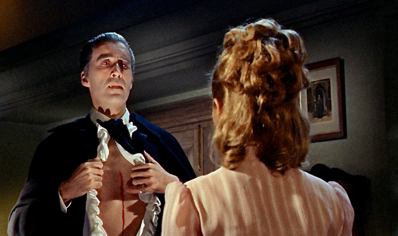 Dracula (Christopher Lee) opens a cut on his chest for Suzan Farmer to drink his blood in Dracula - Prince of Darkness (1966)