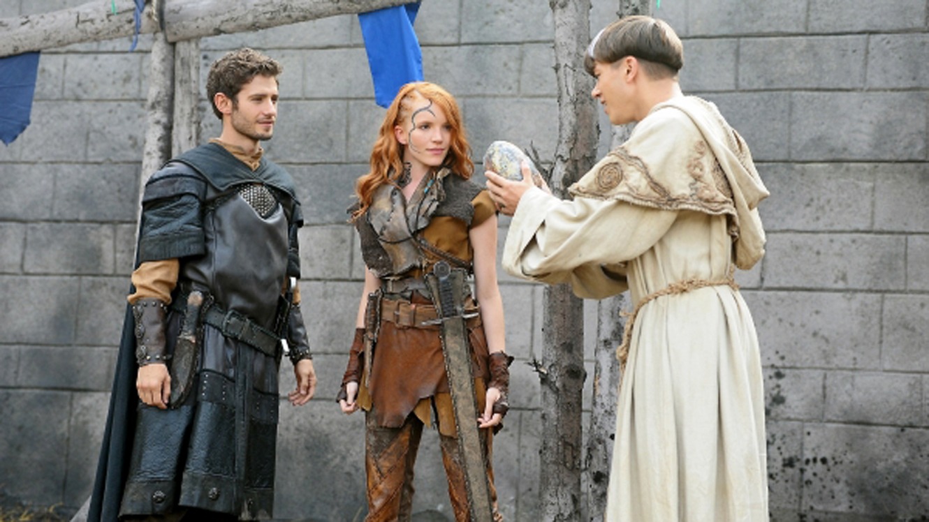 (l to r) Gareth (Julian Morris), Pict girl Rhonu (Tamzin Merchant) as the druid Lorne (Jassa Ahluwalia) shows them a dragon egg in Dragonheart 3: The Sorcerers Curse (2015)