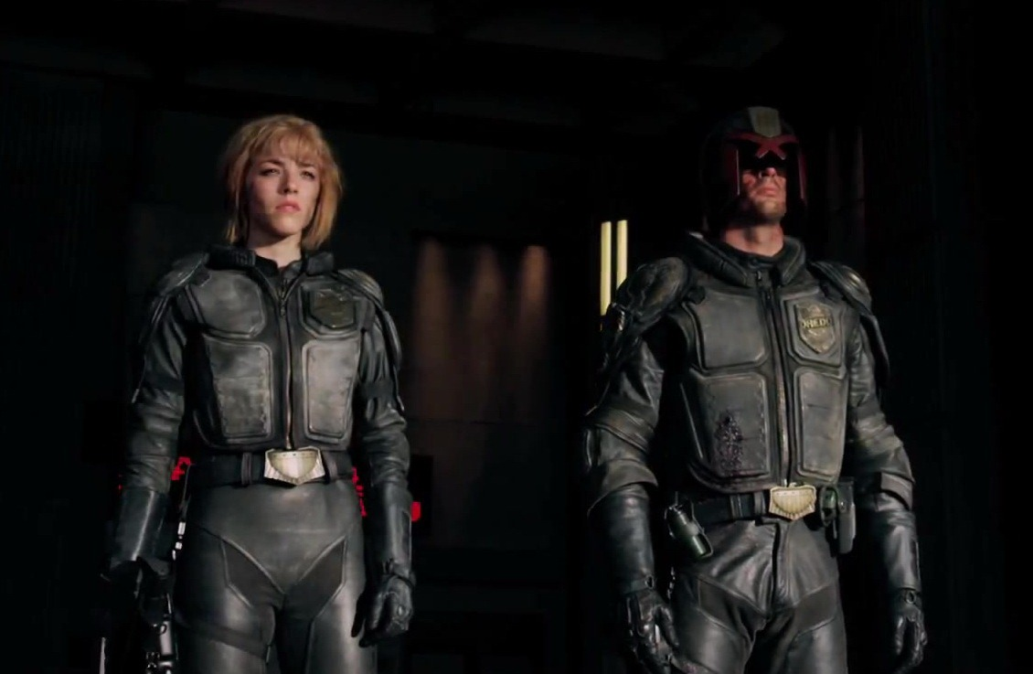 Judge Anderson (Olivia Thirlby) and Judge Dredd (Karl Urban) in Dredd (2012)