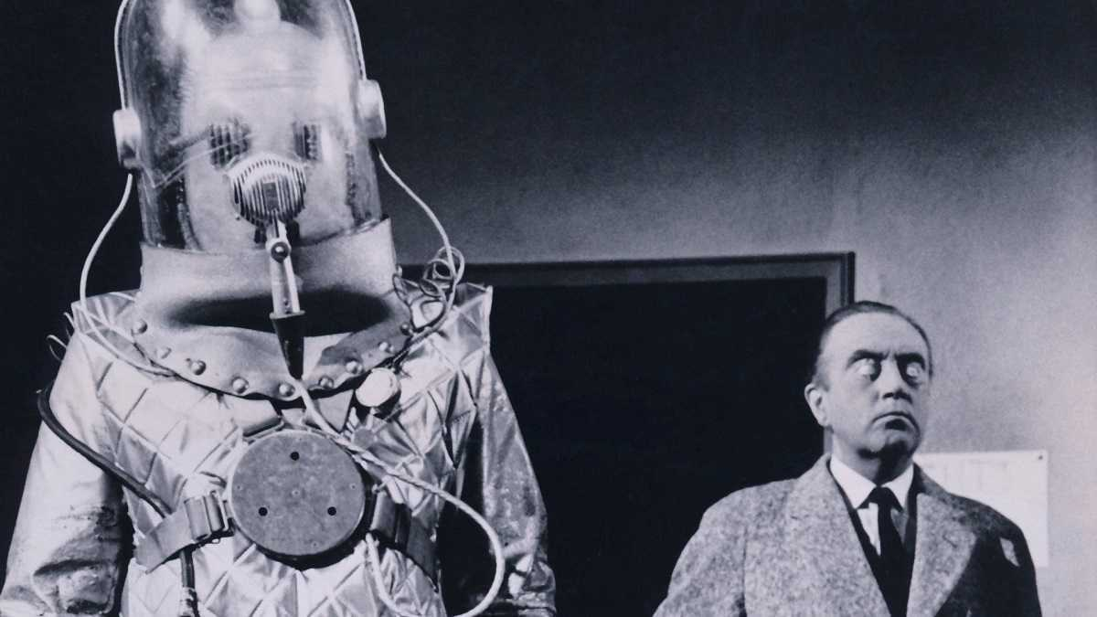 The invading alien robots and a mind-controlled Dennis Price in The Earth Dies Screaming (1964)
