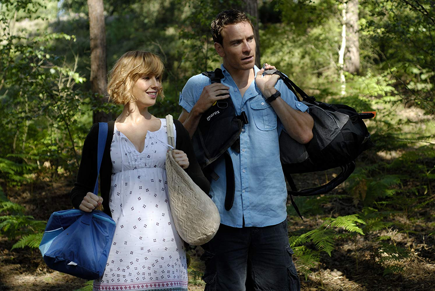 Kelly Reilly and Michael Fassbender as an innocent city couple on a camping trip in Eden Lake (2008)