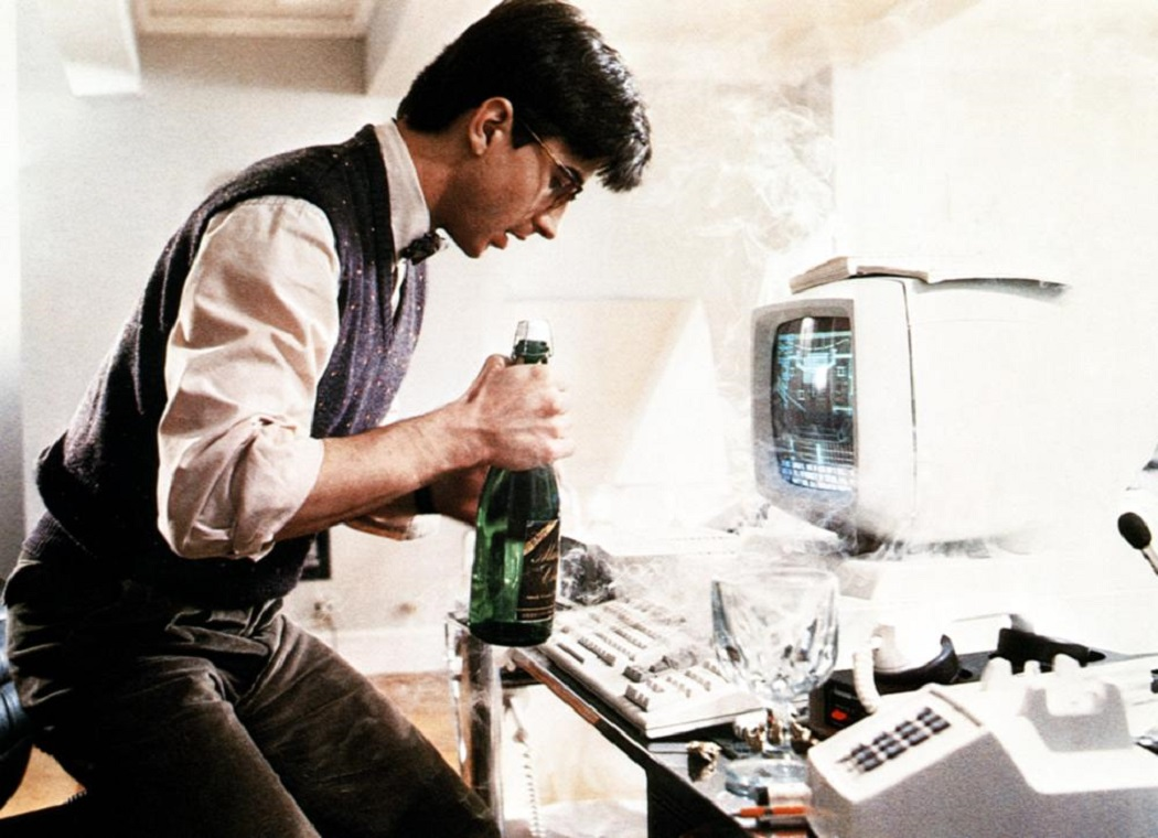 Lenny Von Dohlen's home computer gains sentience after he accidentally spills champagne on it in Electric Dreams (1984)