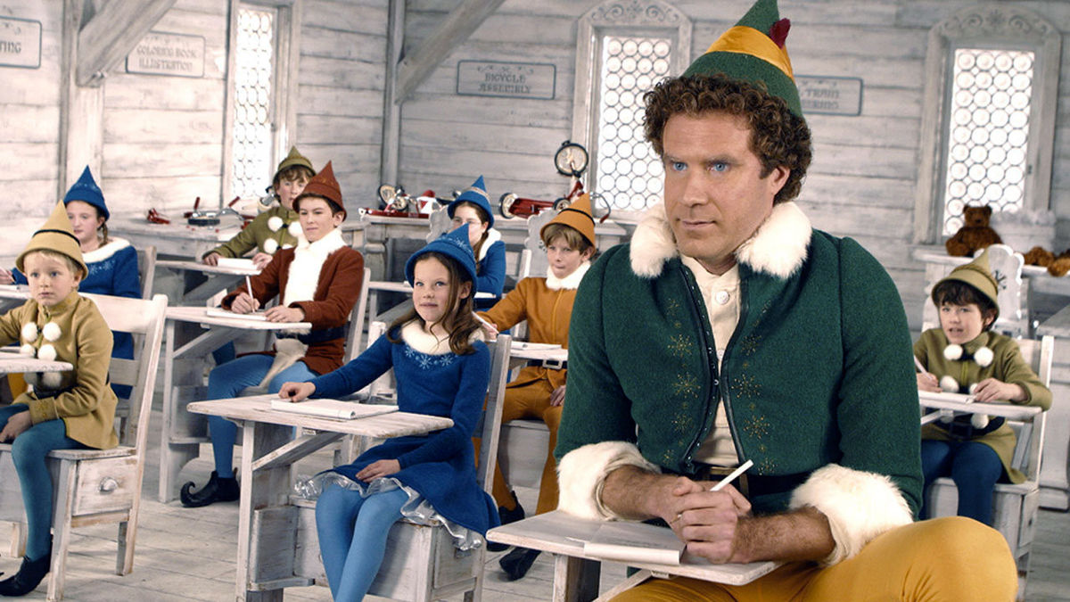 Buddy (Will Ferrell) among the other elves at the North Pole in Elf (2003)