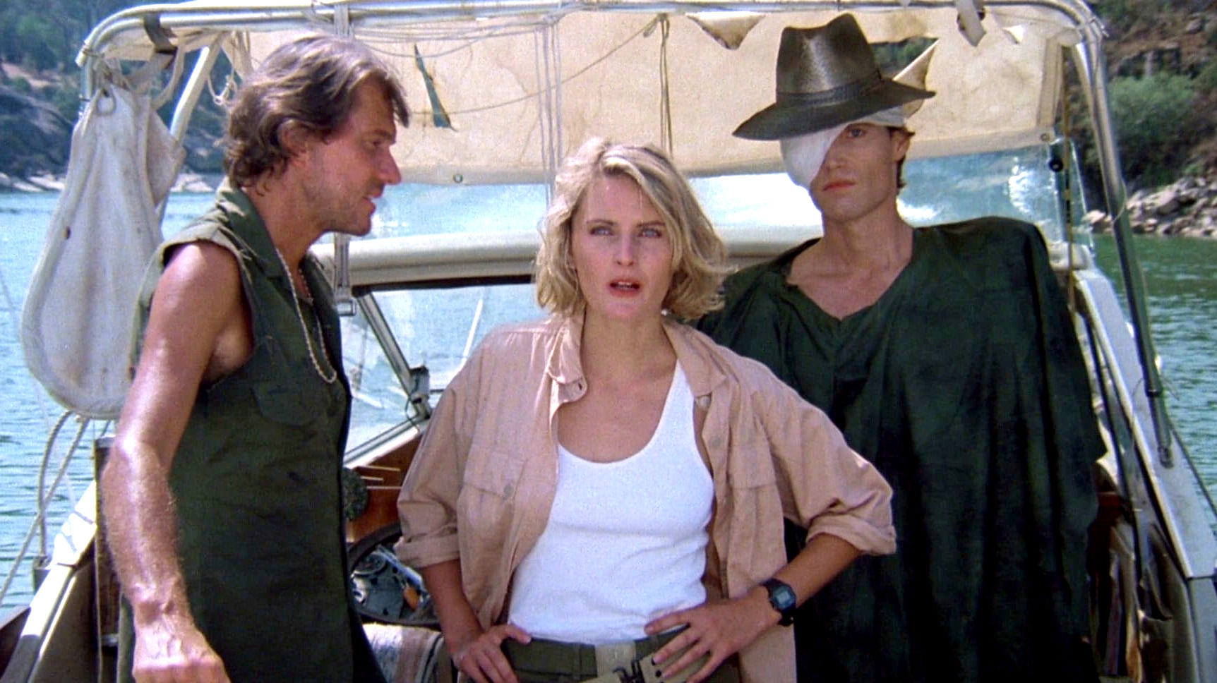 Boat captain Harry Fontana (Andrew Prine), roboticist Nora Hunter (Denise Crosby) and Mandroid (Patrick Reynolds) as the Eliminators (1986)