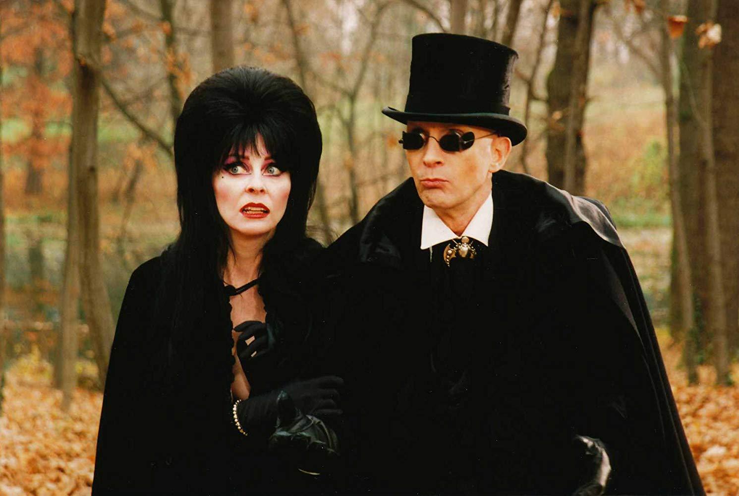 Elvira and Lord Vladimere Hellsubus (Richard O'Brien) in Elvira's Haunted Hills (2001)