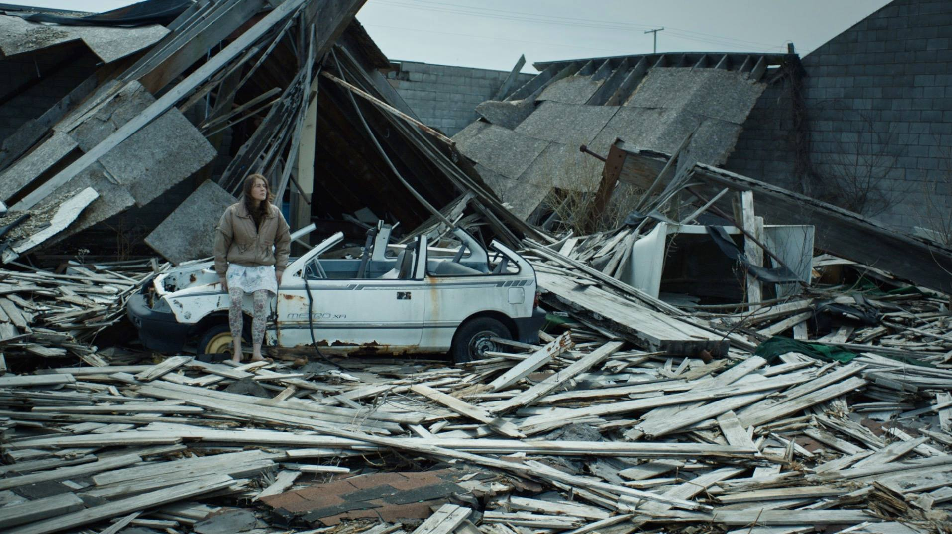 Iva Gocheva stands in the ruins of a house in Embers (2015)