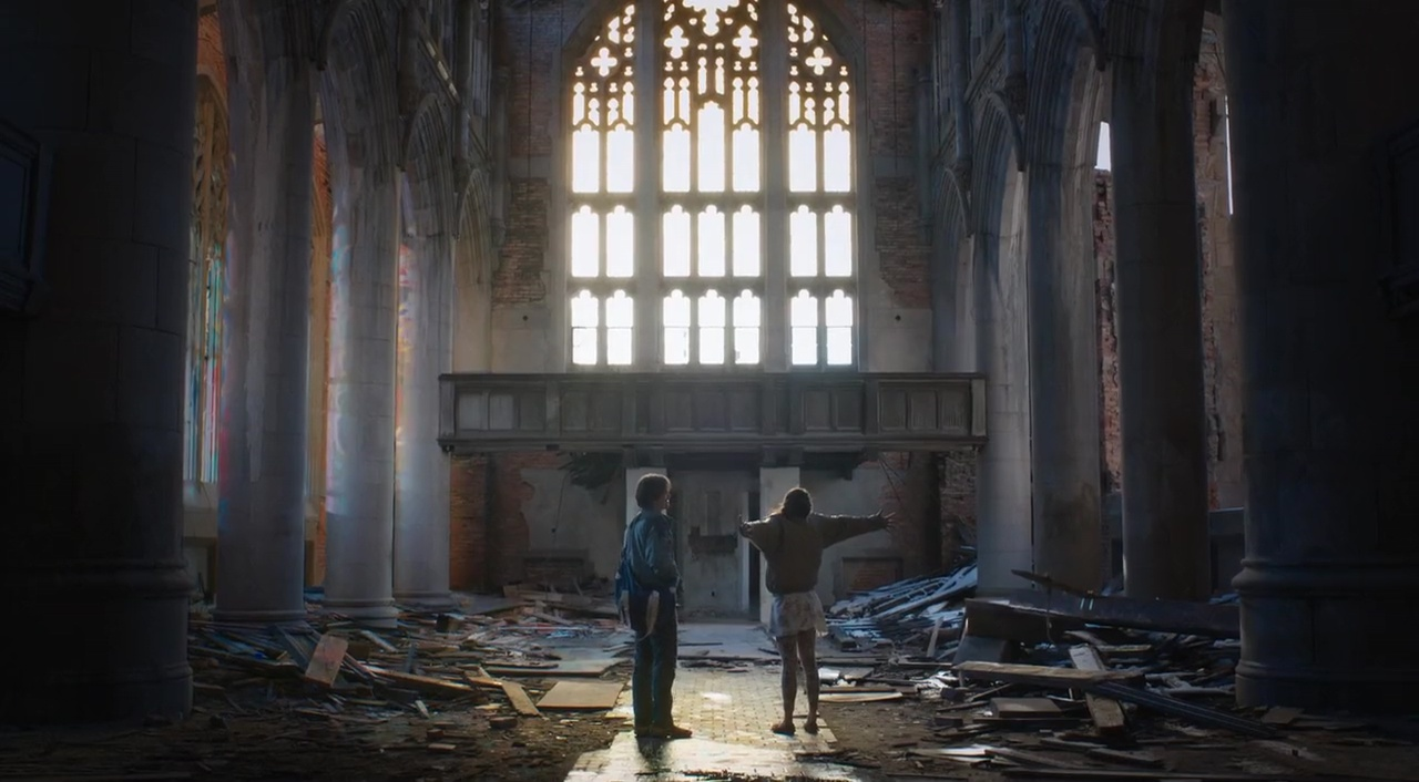 Jason Ritter and Iva Gocheva in the ruins of a church in Embers (2015)