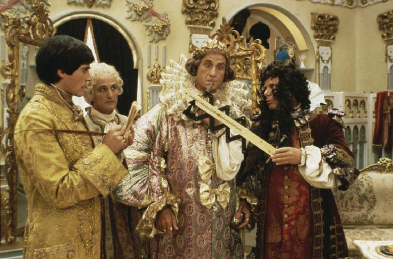 The Emperor (Sid Caesar) is outfitted for his new gown in The Emperors New Clothes (1987)