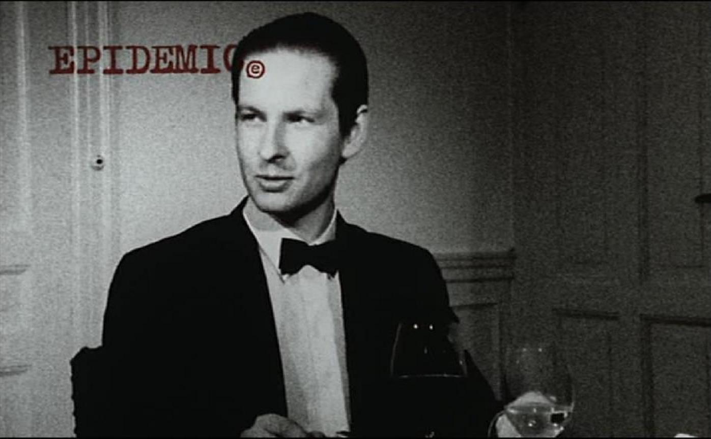 Lars von Trier, playing himself, sits down to a dinner party in Epidemic (1987)
