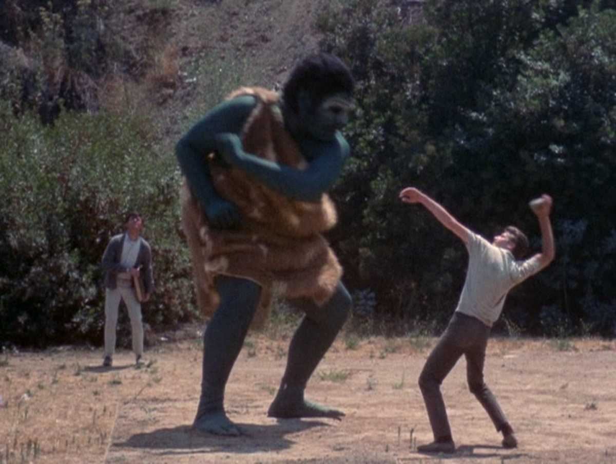 Edward Connell fight off the ape-like demon. With Frank Bonner in the background in Equinox (1970)