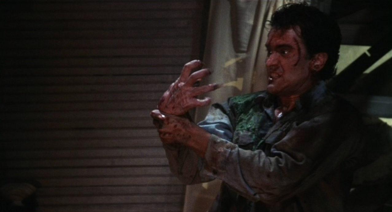 Bruce Campbell fights possessed hand in Evil Dead II (1987)