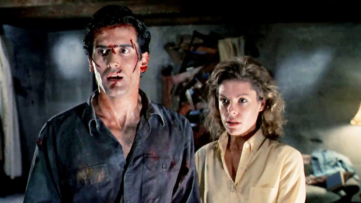 Bruce Campbell and Sarah Berry in Evil Dead II (1987)