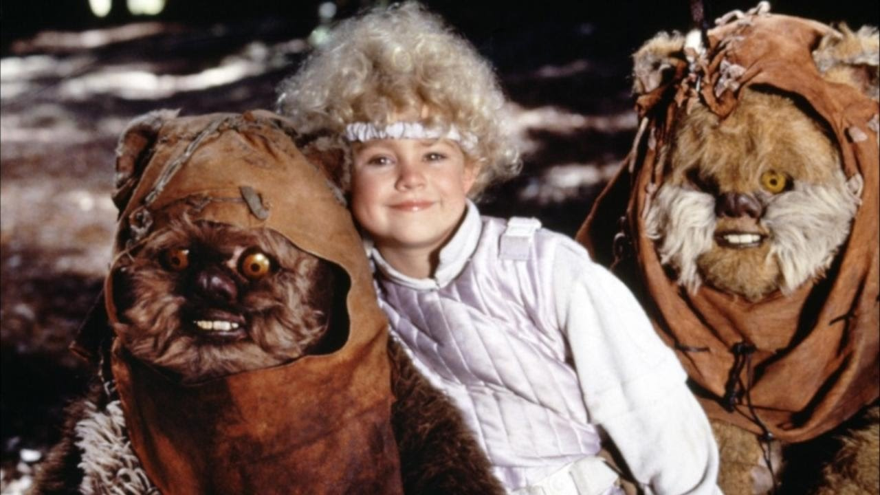 Cindel (Aubree Miller) surrounded by Ewoks in Ewoks and the Marauders of Endor (1986)