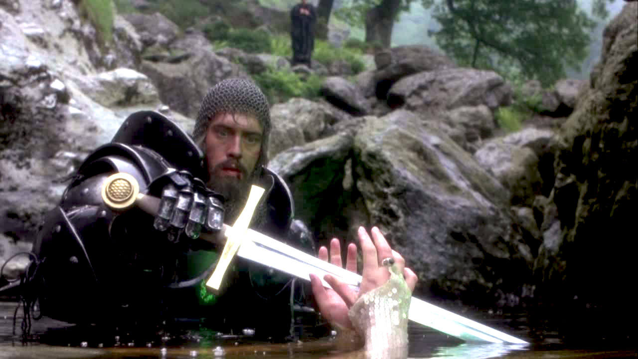 Arthur (Nigel Terry) takes the sword from the Lady of the lake in Excalibur (1981)