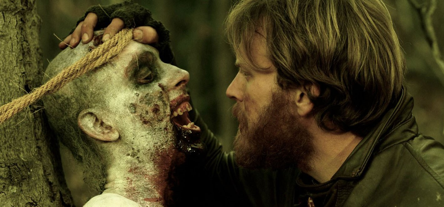 Edward Young (Mark Gibson) and zombie in Exit Humanity (2011)