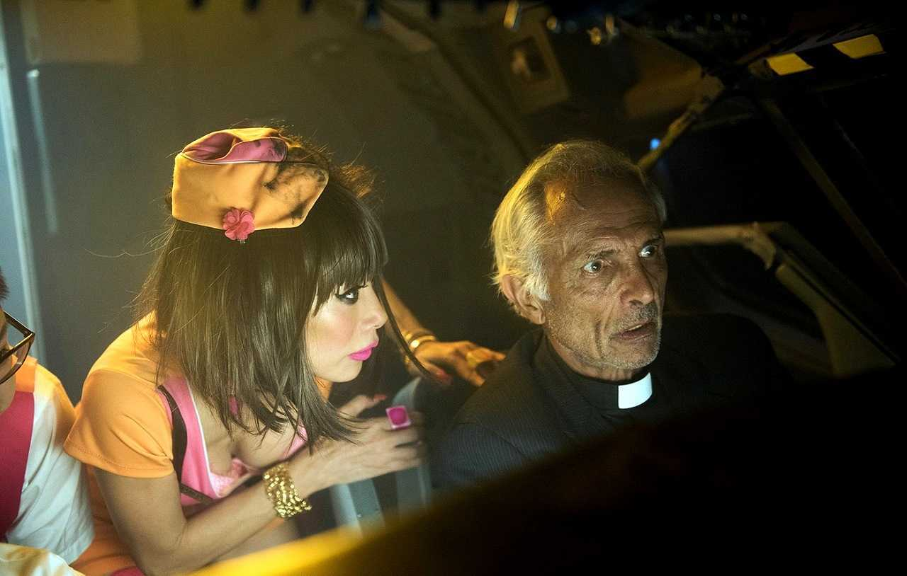 Air hostess Bai Ling and priest Robert Miano in Exorcism at 60,000 Feet (2020)