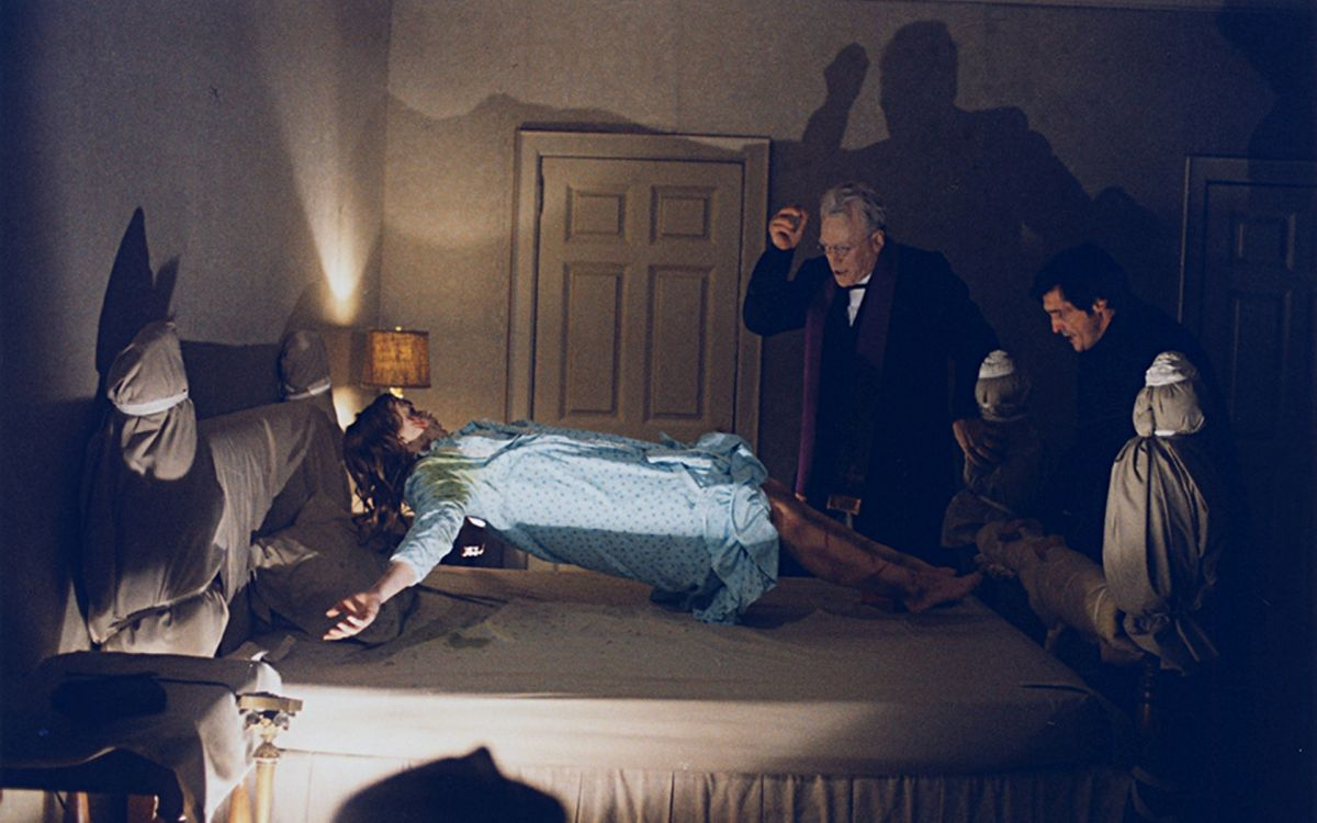 (l to r) Linda Blair in mid-levitation, Father Merrin (Max Von Sydow) and Father Karras (Jason Miller) in The Exorcist (1973)