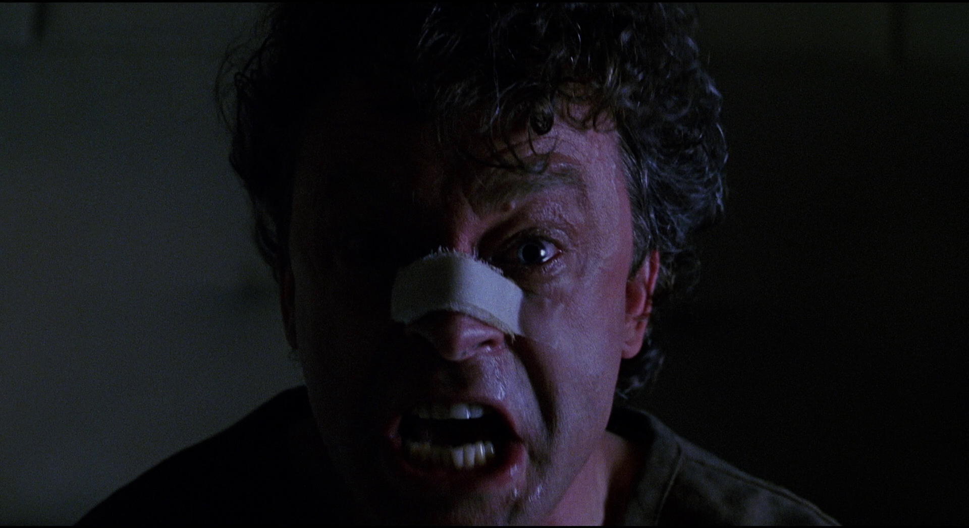 Brad Dourif as the imprisoned Gemini Killer in The Exorcist III (1990)
