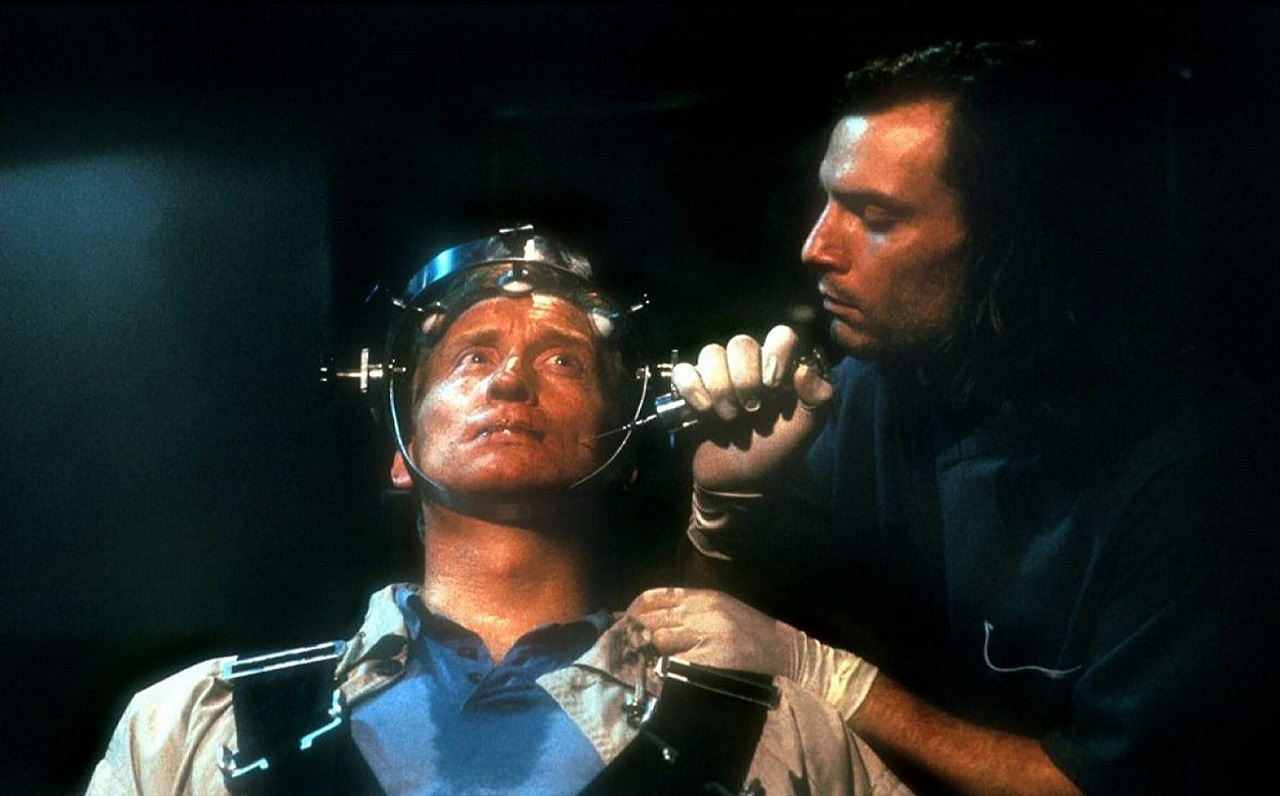 Dr Julian Matar (Sean Haberle) operates on Charles Dance in Exquisite Tenderness (1995)