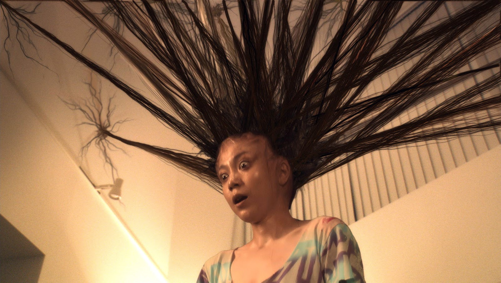 Yuna Natsuo's hair extensions attach themselves to the ceiling in Exte: Hair Extensions (2007)