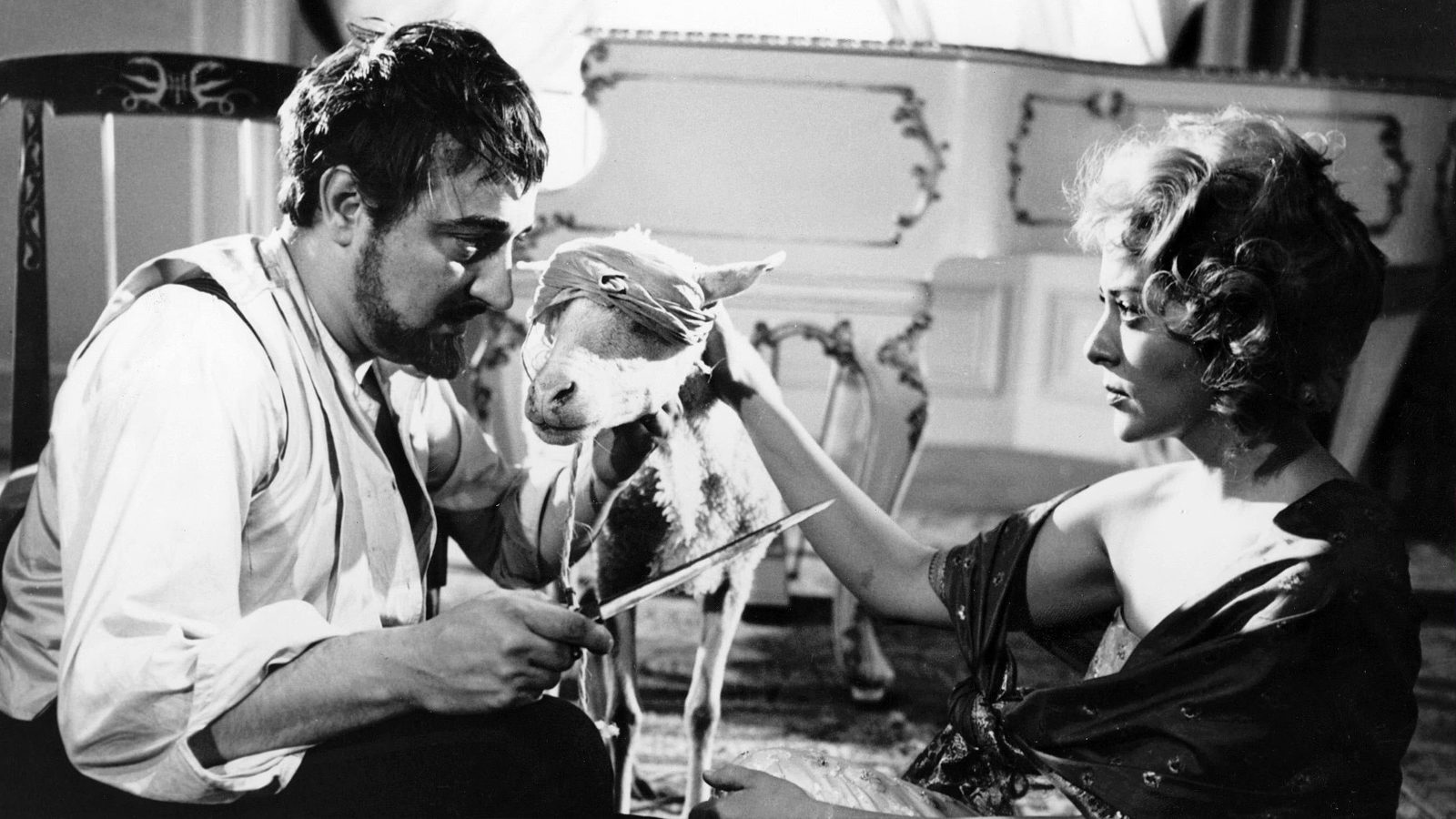 Enrique Rambal menaces Silvia Pinal with a knife in The Exterminating Angel (1962)