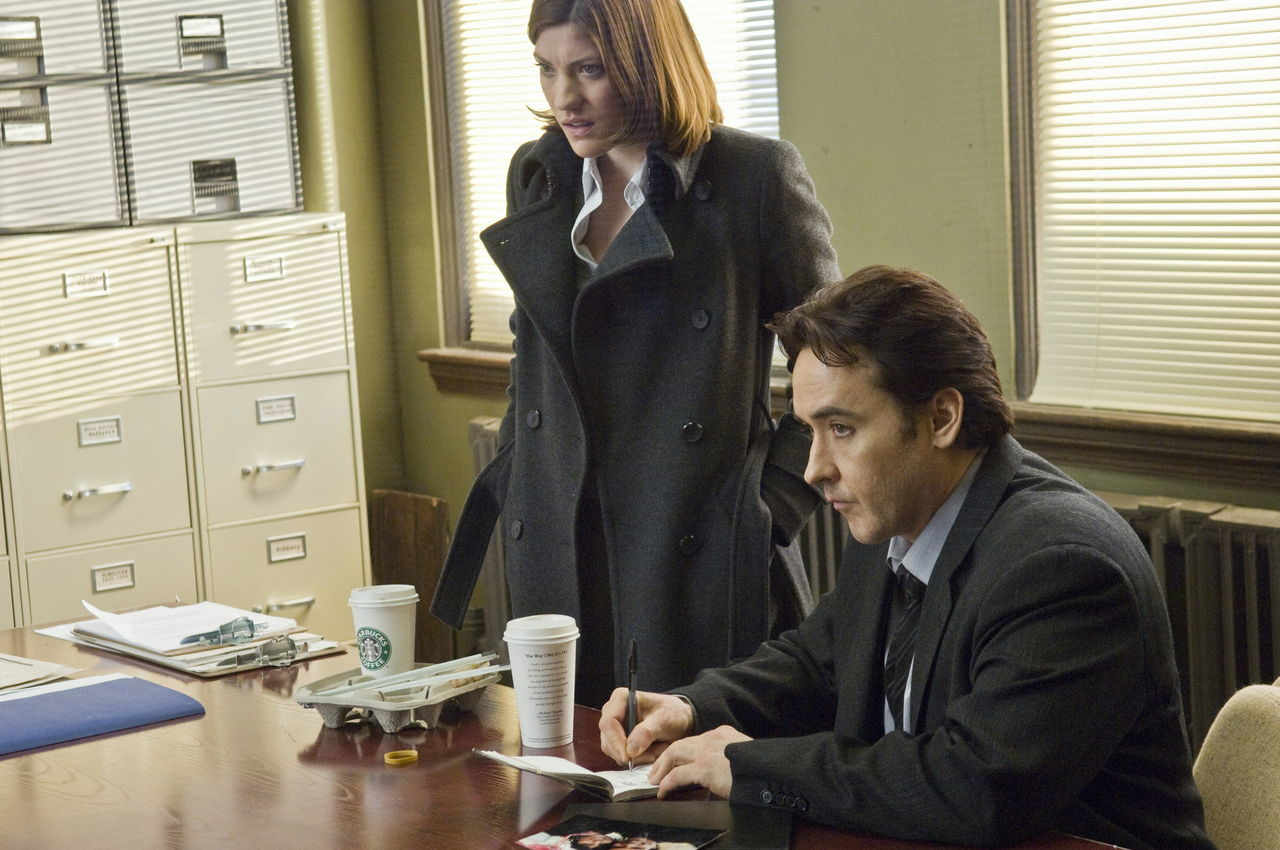 Detectives Jennifer Carpenter and John Cusack in The Factory (2012)