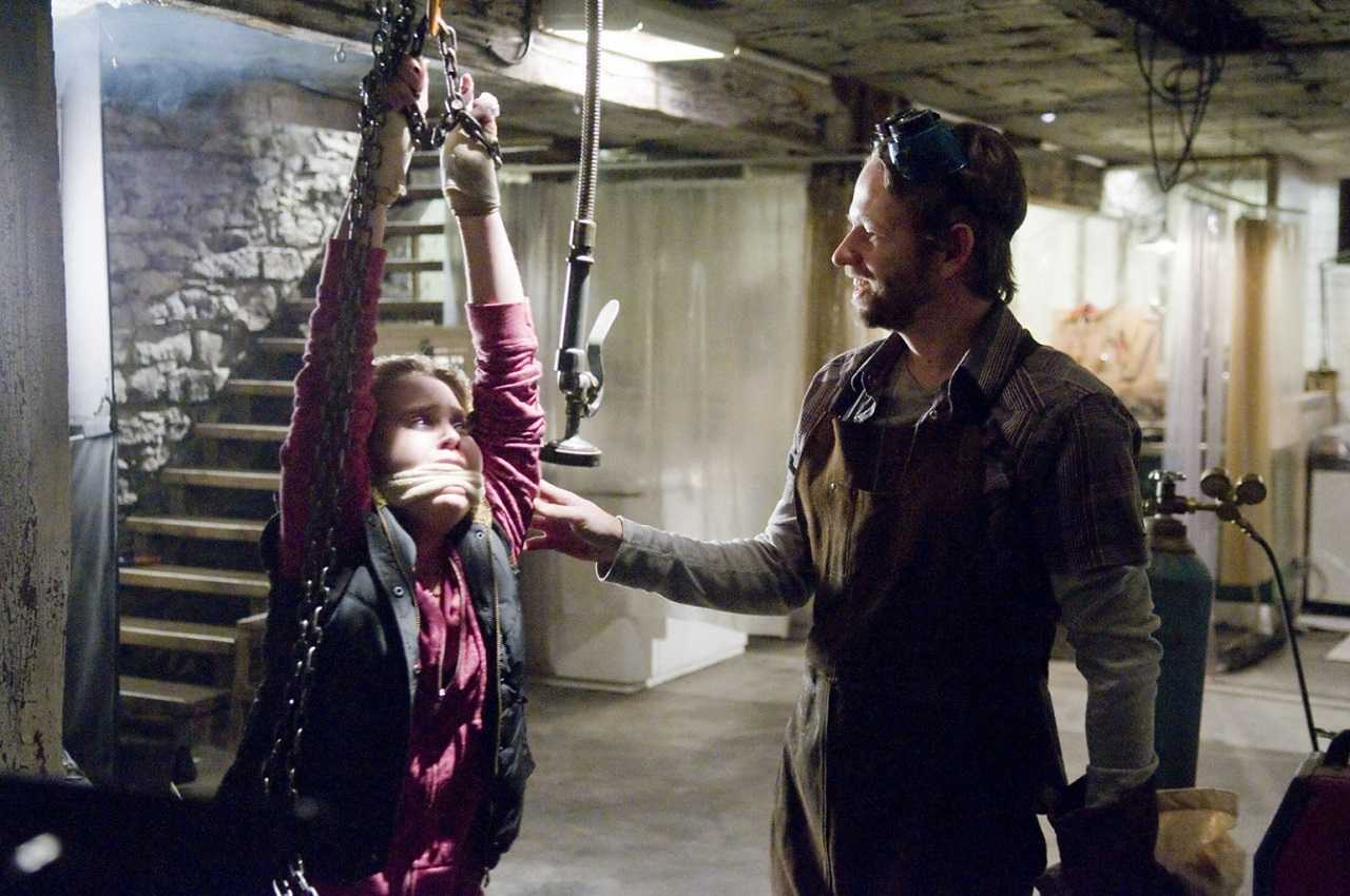 Dallas Roberts with prisoner Mae Whitman in The Factory (2012)