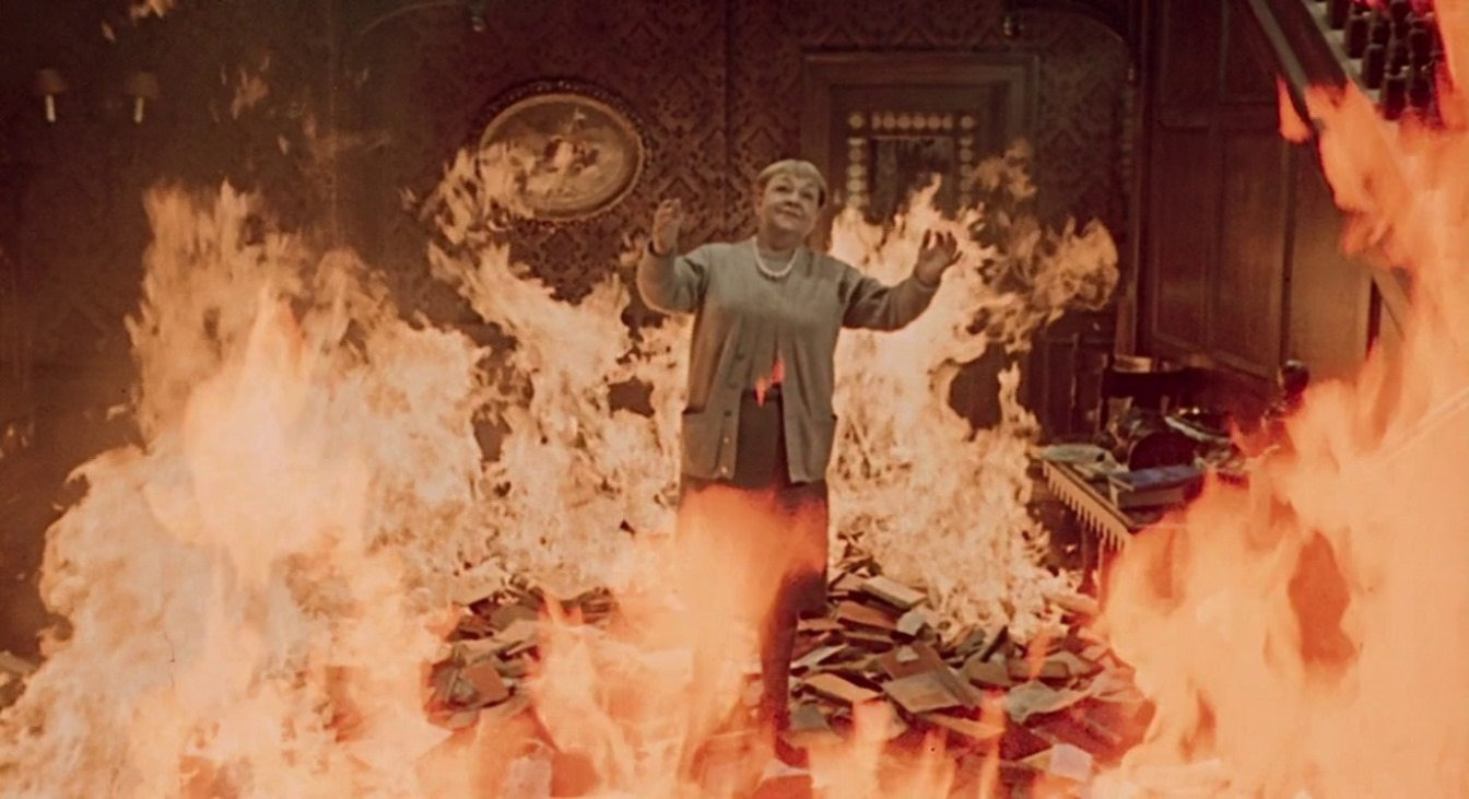 Bee Duffell chooses to be burned along with her books in Fahrenheit 451 (1966)
