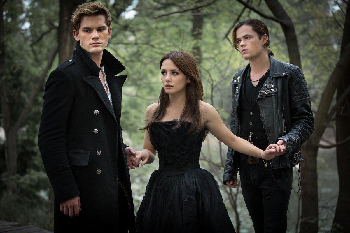Heroine Lucinda Price (Addison Timlin) surrounded by good angel Daniel Grigori (Jeremy Irvine) and bad boy angel Cam Briel (Harrison Gilbertson) in Fallen (2016)