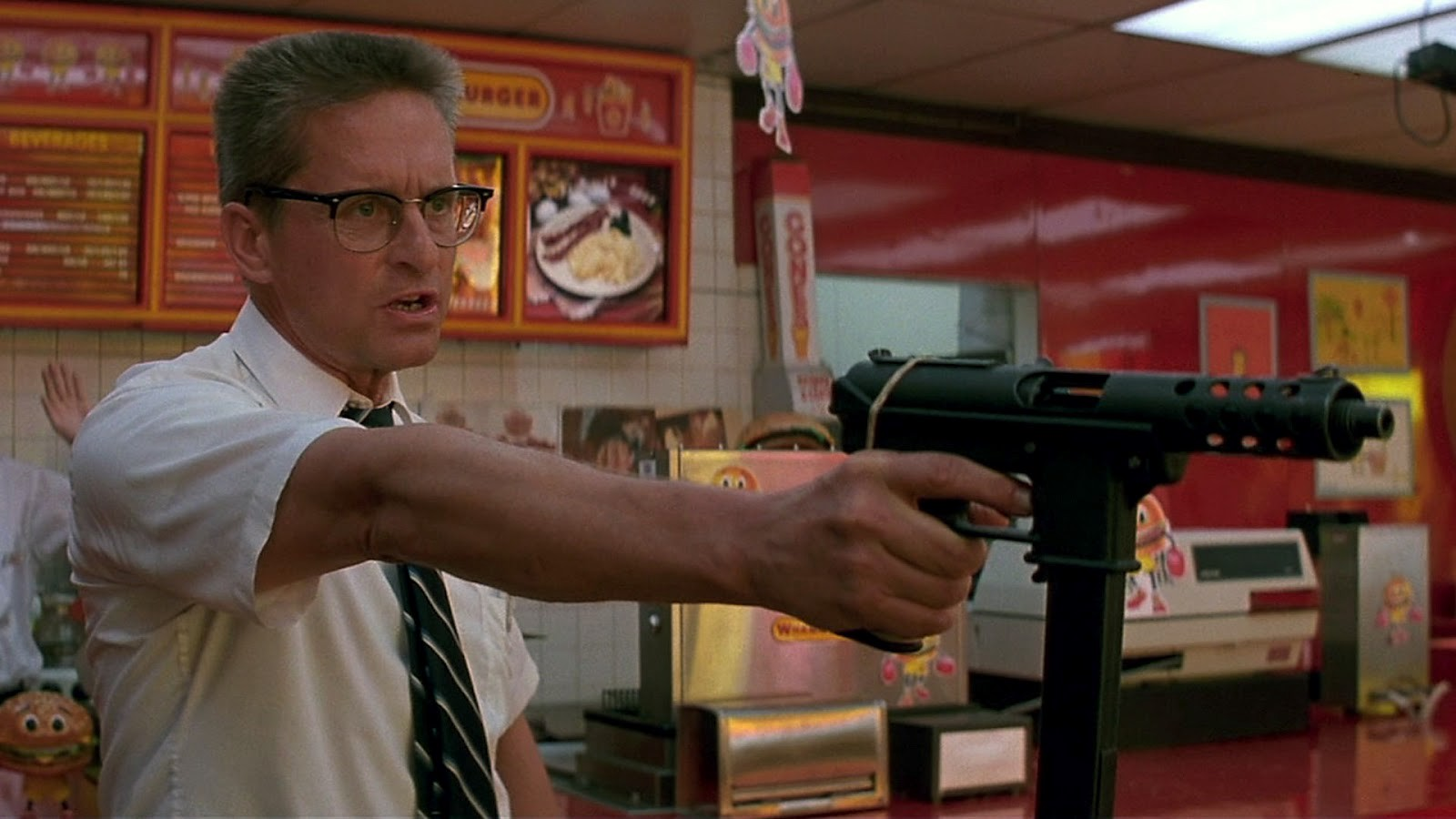 Michael Douglas wields semi-automatic weapons in a fast food restaurant in Falling Down (1993)