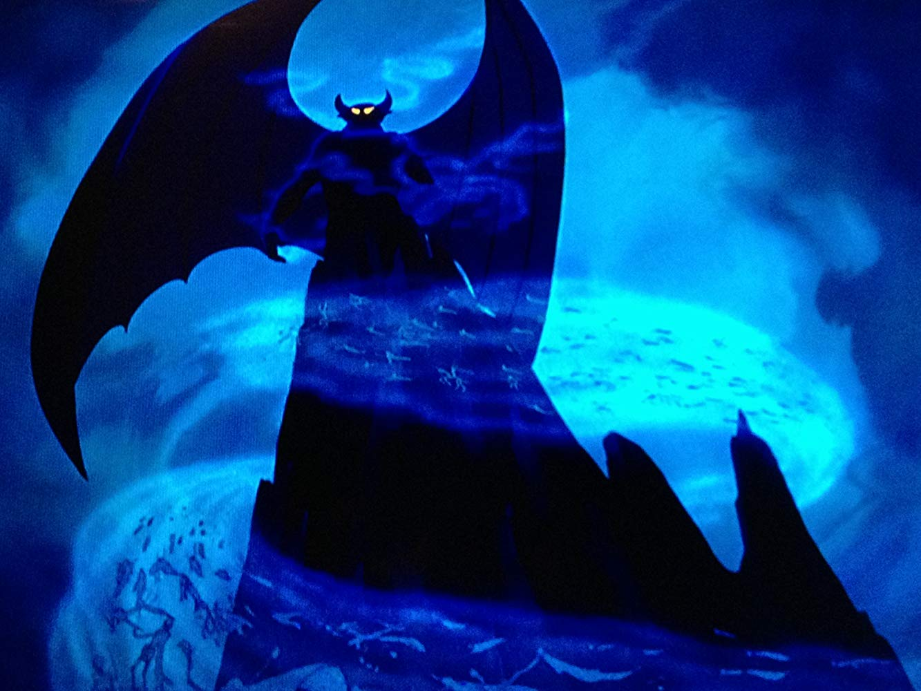 The demon conjures the souls of the dead in the Night on Bald Mountain episode of Fantasia (1940)